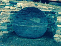 Stone orb with retaining wall by Torben Larsen of Windham Growers